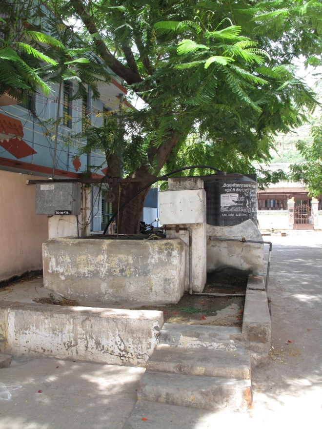 The well stood in the centre of the community. Now the central well has been converted into a bore-well with pipes delivering water to separate houses.