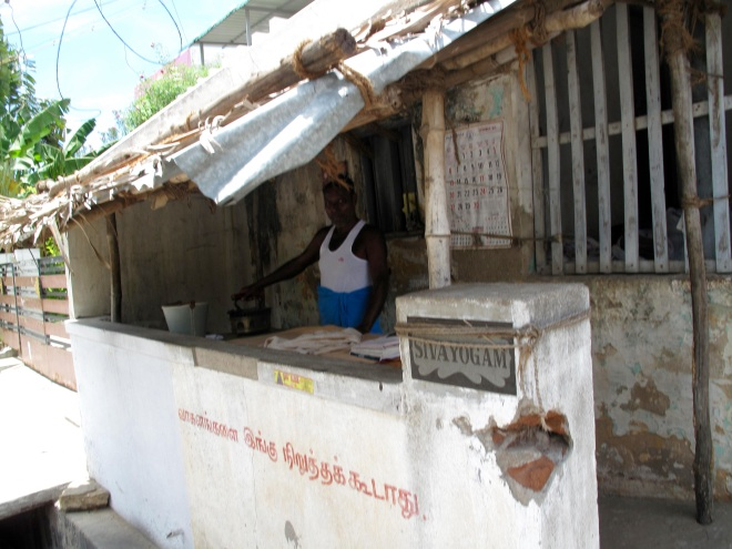 We also have mobile ironing carts but here you see a permanent ironing shop to which women bring their big bundles of clean washing for the ironing professional to deal with.